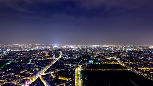 the city skyline at night. paris, france. taken from the tour montparnasse timelapse - montmatre utsikt bildbanksvideor och videomaterial från bakom kulisserna