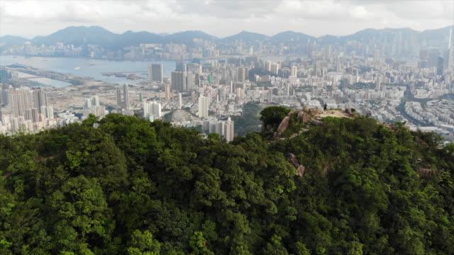 the city view of lion rock in hong kong - hong kong video stock e b–roll