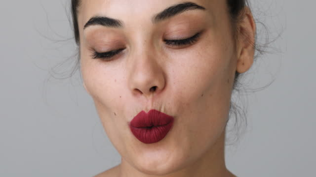 the close up shot of woman whistling - collagene video stock e b–roll