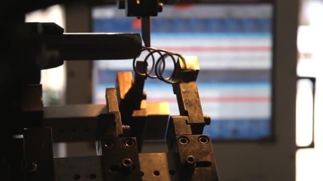 the coil spring manufacturing machine - molla video stock e b–roll