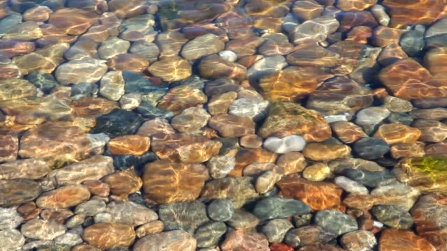 the colored stones in the water