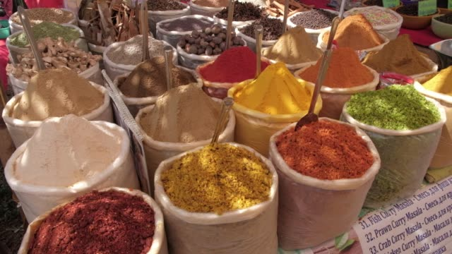 The colouful flea market and beaches of Goa Indian and Southeast Asian dry masalas and spices for sale at a flea market stall in the popular destination of Anjuna beach in Goa, India popular with local and foreign tourists spice stock videos & royalty-free footage