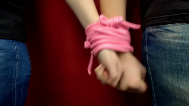 vídeos y material grabado en eventos de stock de el concepto de la relación entre un hombre y una mujer. - amarrado