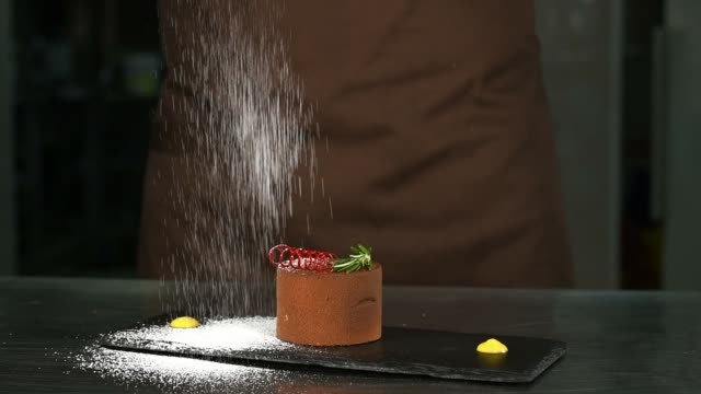 the confectioner pours chocolate dessert icing sugar - desserts stock videos and b-roll footage