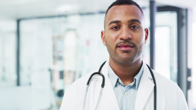 The confidence it takes to deliver quality patient care 4k video footage of a confident young doctor working in a modern hospital general practitioner stock videos & royalty-free footage
