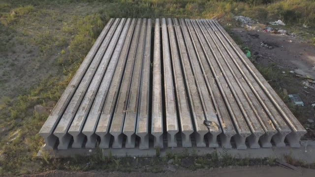 The construction site of the traffic intersection. Reinforced concrete beams for the construction of an overpass. Construction Materials. Reinforced concrete structures. Aerial view