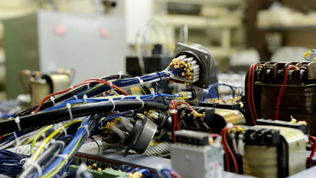 The control system of a modern CNC machine. Cable harnesses video