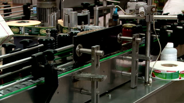 the conveyor at the factory for the production of tomato sauce ketchup adzhika mustard seasonings - autoclave video stock e b–roll