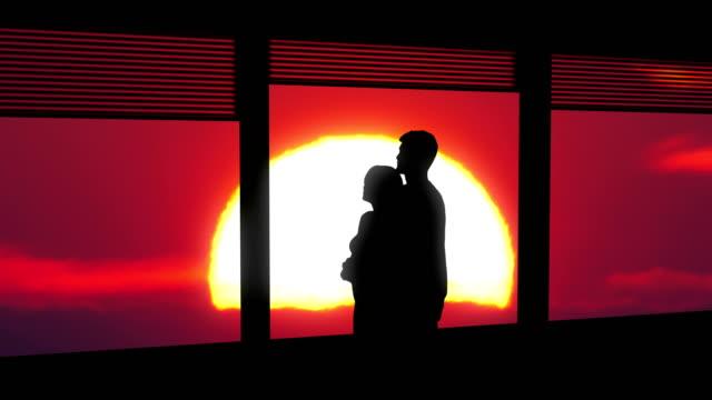 the couple hugs near the window on a bright sun background - man look sky scraper video stock e b–roll