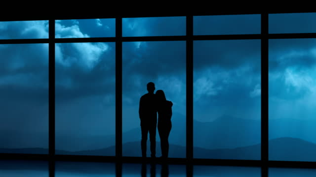 the couple standing near windows on a cloud stream background. time lapse - man look sky scraper video stock e b–roll