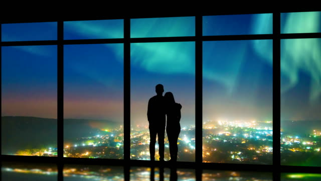 the couple standing near windows on the foggy city background. time lapse - man look sky scraper video stock e b–roll