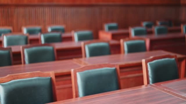 The court room considered cases related to various cases. The court room considered cases related to various cases. legal trial stock videos & royalty-free footage
