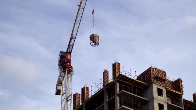 The crane moves the load on the building site. video