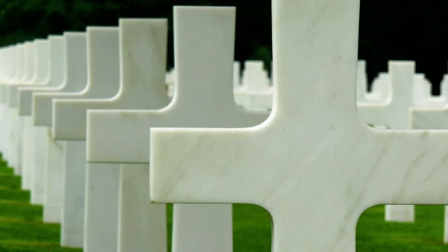 The cross aligned straight on the cemetery video