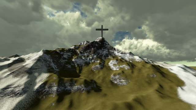 The cross on top of snowy mountain video