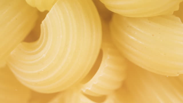 The curves of the pasta. Close-up and General view The curves of the pasta. Close-up and General view macaroni stock videos & royalty-free footage