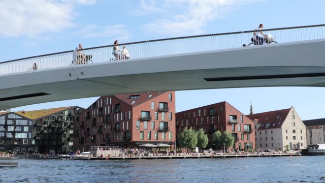 The cyclists traffic on the bridge The cyclists traffic on the bridge, view from the water, Copenhagen denmark stock videos & royalty-free footage