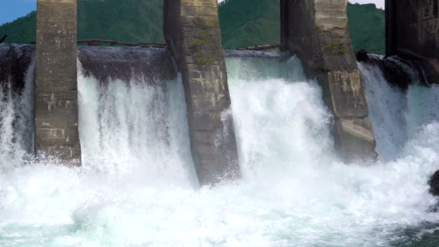 The dam of a hydroelectric power station. The dam of an abandoned hydroelectric power station located on a mountain river. siberia stock videos & royalty-free footage