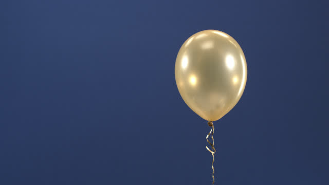 The decorative element - a golden balloon - appears in the video as a surprise on a colored key, a gift item for Valentine's Day, Birthday, Christmas or New Year. video