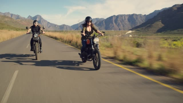 The definition of a joyride 4k video footage of two attractive young women riding their motorcycles on the open road motorcycle stock videos & royalty-free footage