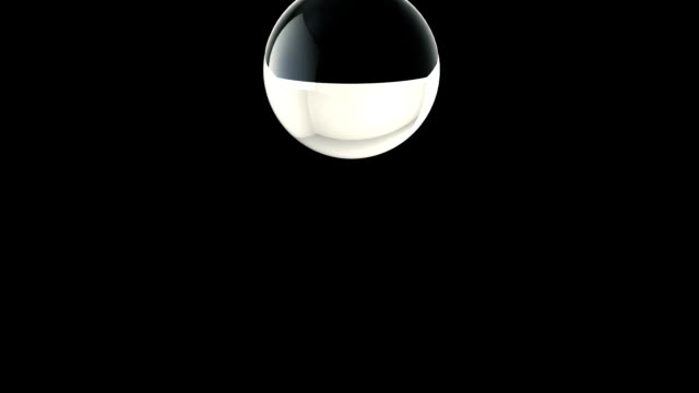The destruction of the glass sphere in slow motion on a black background video