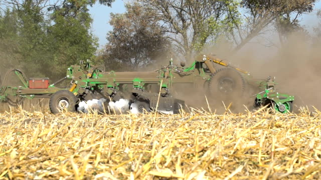 The disc harrow in the work The disc harrow in the work. Soil cultivation after harvesting corn. Slow motion harrow agricultural equipment stock videos & royalty-free footage