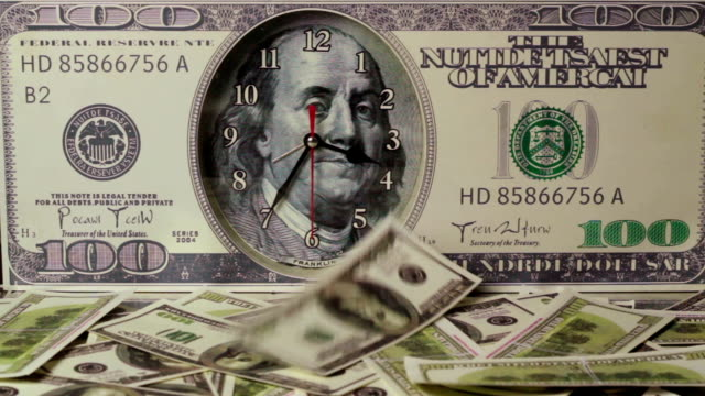 The dollars are falling on the background of hundred dollar bills.Us dollars.