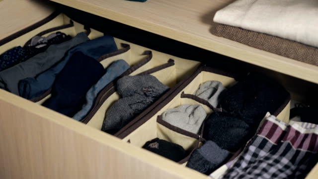 the drawer with underwear in the closet. - calzino video stock e b–roll