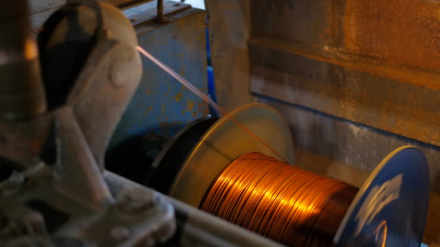 The drawing process of copper wire in the old cable factory. The drawing process of copper wire in the old cable factory copper stock videos & royalty-free footage