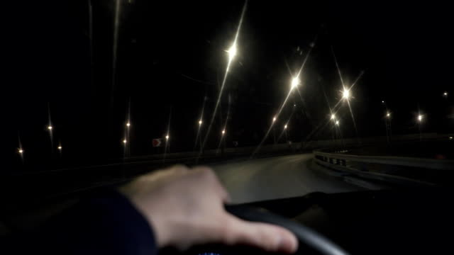 The driver drives a car through the night city, the beautiful streets video