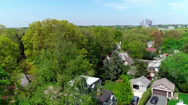 The drone aerial view of the residential district at the sunny spring day. Pelham Manor, Westchester County, New York State. video