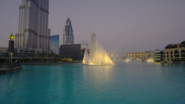 The Dubai Fountain water show at dusk