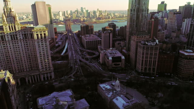 the elevated panoramic view of manhattan downtown, new york city. vertical panoramic movement of the camera from below up - szerokokątny filmów i materiałów b-roll