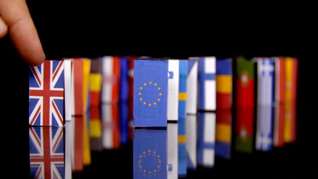 The Eu Dominos Fall. Flags of European Countries like a domino falling down