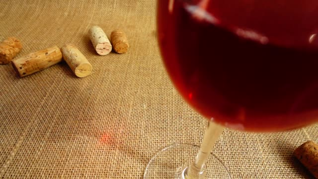 The fall of wine corks against the background of glasses and bags. Slow motion. The fall of wine corks against the background of glasses and bags. Slow motion. cork stopper stock videos & royalty-free footage