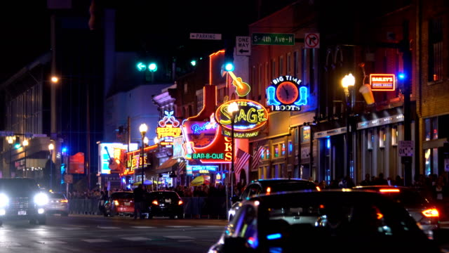 the famous beale street with neon signs of bars and pubs in memphis, tennessee - bar video stock e b–roll
