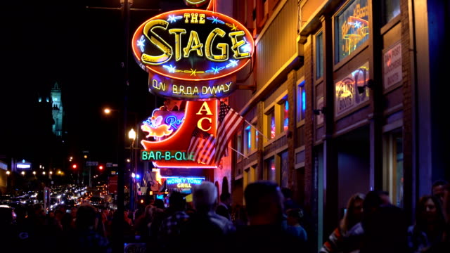the famous beale street with neon signs of bars and pubs in memphis, tennessee - bar lokal gastronomiczny filmów i materiałów b-roll