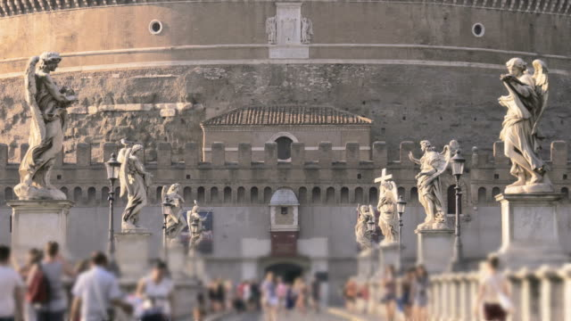 The famous bridge Ponte Sant'Angelo crossing the river Tiber and Castel Sant'Angelo in Rome video