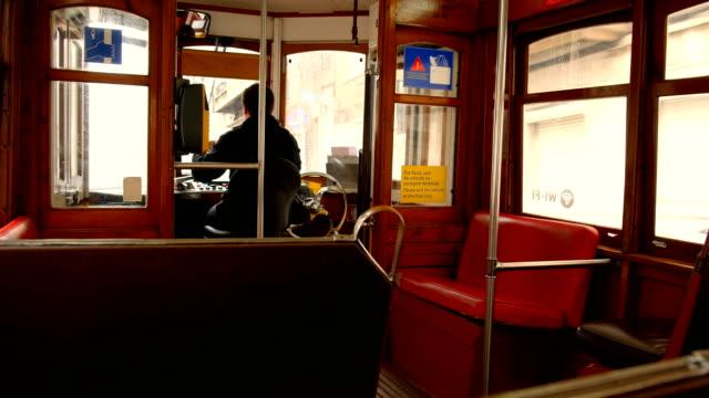 vídeos de stock e filmes b-roll de the famous empty tram twenty eight, roof detail, tourist destination par excellence in lisbon - eletrico lisboa
