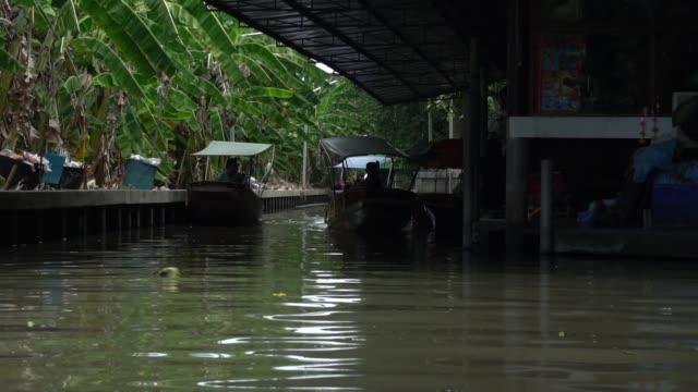 The famous Floating Market located in Damnoen Saduak near Bangkok, Thailand.
