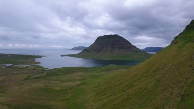The famous Kirkjufell mountain in Iceland seen from the air video