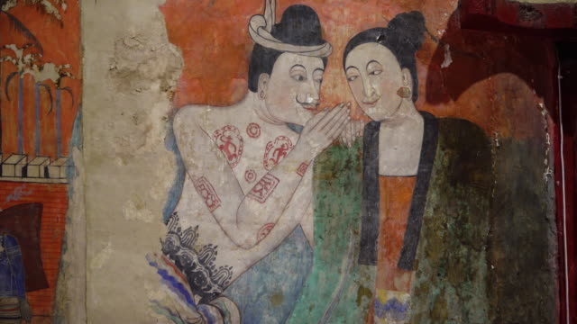 the famous whispering lovers murals on wall of wat phumin the most attractive temple in the town of nan province,thailand - wat video stock e b–roll