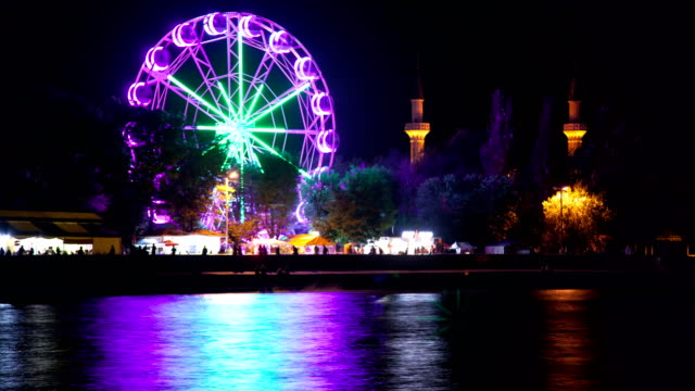 The Ferris wheel glows at night. video