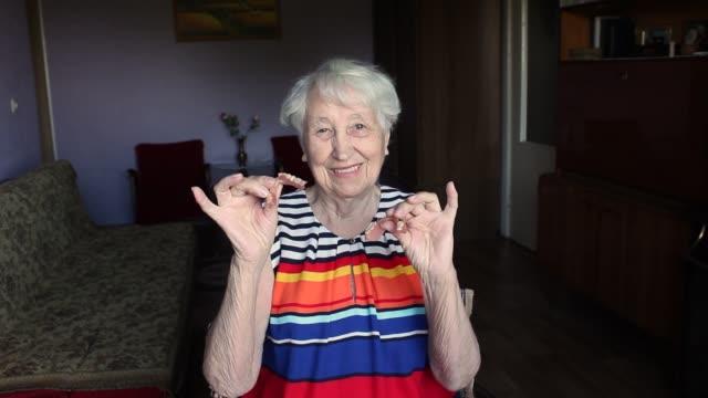 The flexible nylon dentures in senior female hands. Dental concept