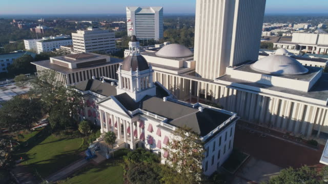 The Florida State Capitol, Tallahassee.  Aerial drone video with the cinematic complex ascending and tilting-down camera motion.