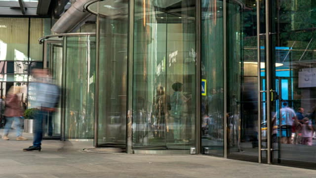 the flow of people passing through the revolving door of the modern office building at the end of the working day,time lapse the flow of people passing through the revolving door of the modern office building at the end of the working day,time lapse lobby stock videos & royalty-free footage