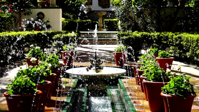 The fountain in the yard of house-museum of Sorolla. Slow motion.The house has been built in 1909 — 1910. video