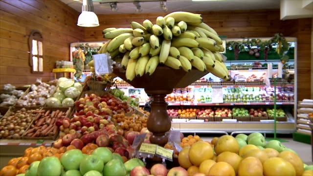 the fruit on the counter in the supermarket. Fruit abundance.