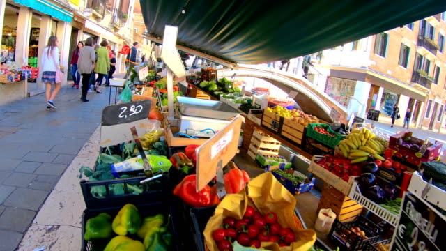 The fruits and vegetables on the boat in Venice Italy video