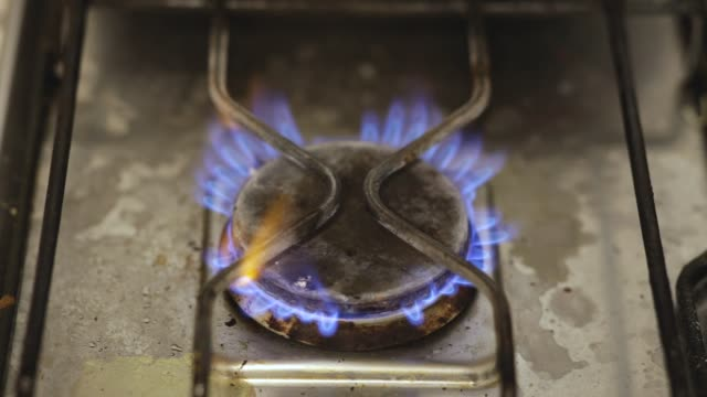 The gas burner burns with a blue flame. video